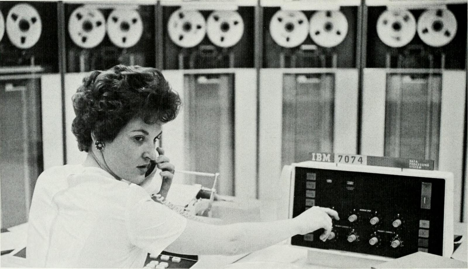 Woman on telephone using IBM 7074